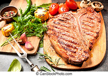 Grilled T-bone steak - Grilled beef steak with vegetables on...