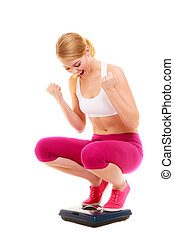 Happy successful woman weighing scale. Dieting. - Happy...