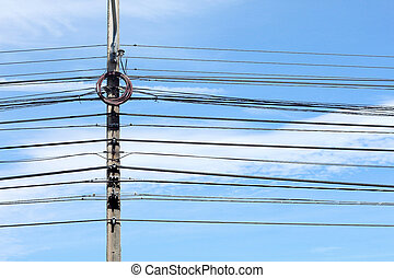 Electricity poles and wires with blue sky