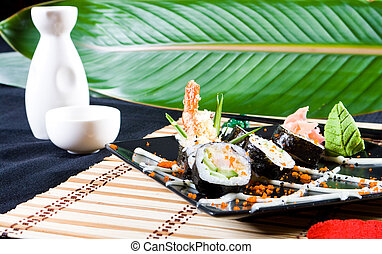 sushi and saki in a restaurant style serving