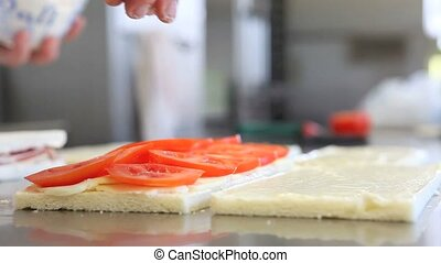 hands season tomato for sandwich - hands season with salt...