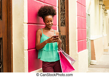 Black Girl Shopping And Text Messaging On Phone - African...
