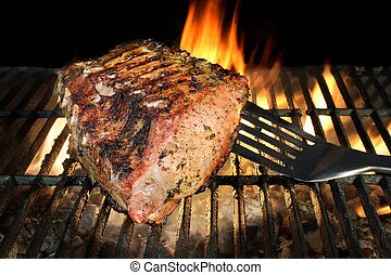 BBQ Grilled Pork Chop With Ribs On The Hot Grill.