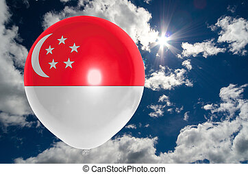 balloon with flag of singapore on sky - balloon in colors of...