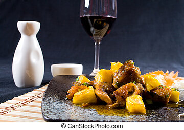chicken and saki wine - a plate of bright sweet and sour...