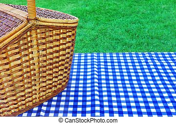 Picnic Basket On The Table With Blue White Tablecloth -...