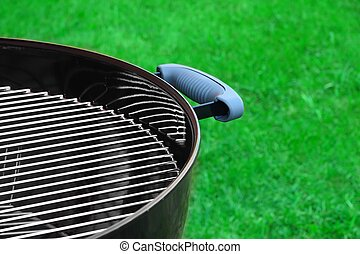 BBQ Grill On The Backyard Lawn Close-up - New BBQ Grill In...