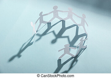 Group of people holding hands - Group of people made of...