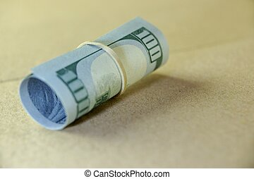 Money Roll With US New One Hundred Dollar Bill