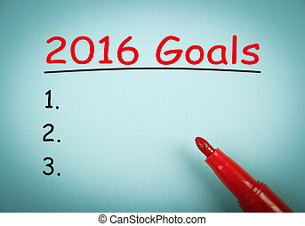 2016 Goals is on blue paper with a red marker aside.