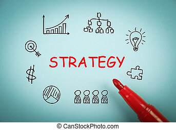 Strategy concept is on blue paper with a red marker aside