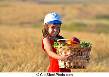 Jewish Israeli girl with fruit basket on Shavuot Jewish...