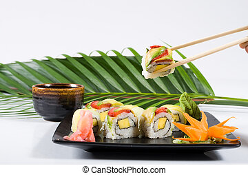 colorful sushi - delicious colorful sushi with leaf in...