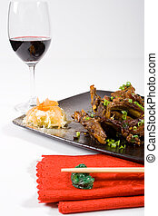 meal - a chinese meal consisting of lamb chops and wine