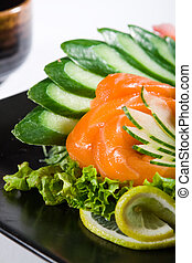 salmon - fresh salmon on plate with raw vegetables
