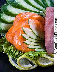 salmon and tuna sashimi - raw salmon and tuna sashimi with...