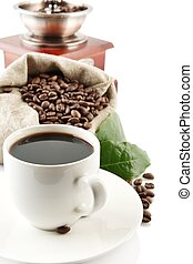 Cup of coffee with mill,bag full of coffee beans on white -...