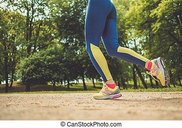 Runner running outdoors wearing leggings - Runner running...