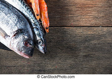 Fresh catch fish on wooden background