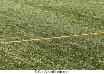 football pitch with yellow lines