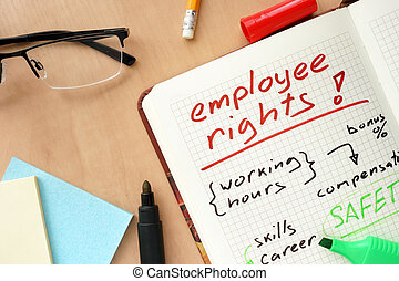 Notepad with word employee rights concept and glasses