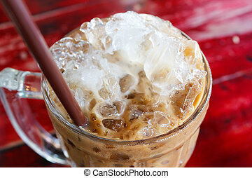 Iced coffee. - iced coffee with straw in glass cup.