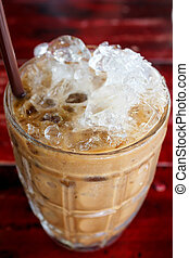Iced coffee - iced coffee with straw in glass cup
