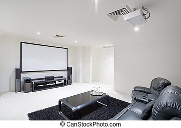 Home Theatre Room - home theater room with black leather...