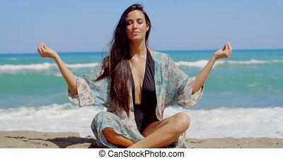 Gorgeous Lady at the Beach Doing Yoga Exercise