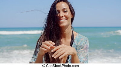 Happy Woman at the Beach Looking at Camera