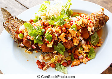 Deep fried fish with herb and spicy sauce. - deep fried fish...