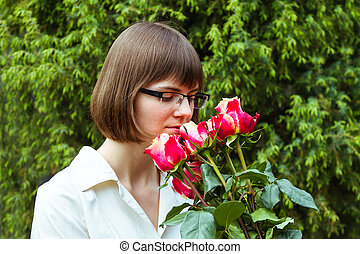 young wooman with roses - young wooman with scarlet roses on...