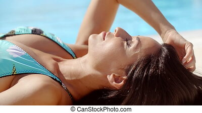 Gorgeous Young Lady Sunbathing at the Poolside - Close up...