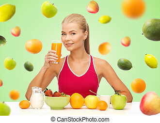 happy woman holding glass of orange juice - healthy eating,...