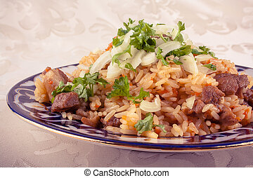 Traditional uzbek meal called pilaf in vintage look -...