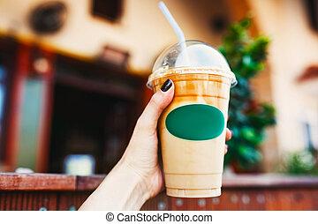 Take away coffee cup - Young woman holding take away coffee...