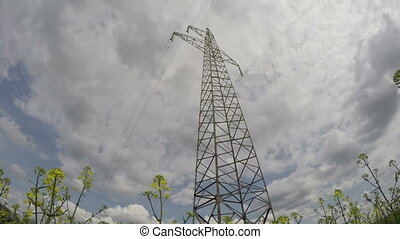 electricity high voltage tower construction and evening...