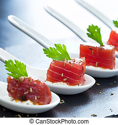Macro close up of tuna appetizers. - Extreme close up of...