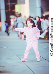 Happy Asian girl running in vintage tone.