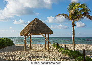 Beach Hut - A beach hut on the sand along the coastline in...
