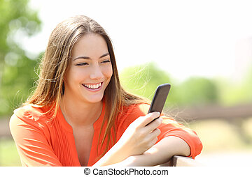 Girl using a smart phone in summer