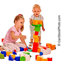 Children play building blocks. - Happy children girl and boy...