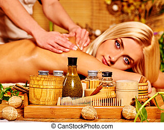 Woman getting massage - Blond woman looking at camera and...