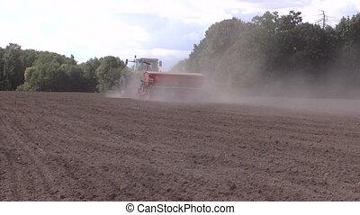 fertilize work field dust - Dust rise from tractor fertilize...