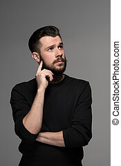 Fashion portrait of young man in black - Fashion portrait of...