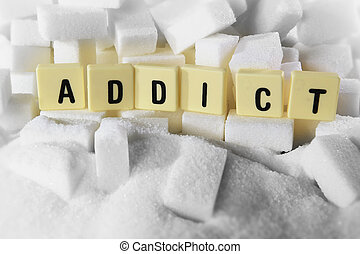 addict block letters word on pile of sugar cubes close up in...