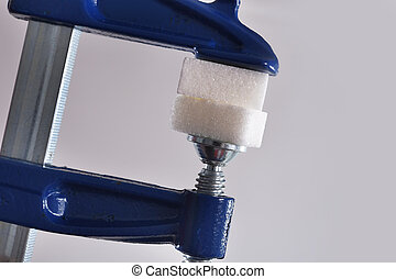 gag tool grabbing sugar cubes in sugar abuse and addiction...