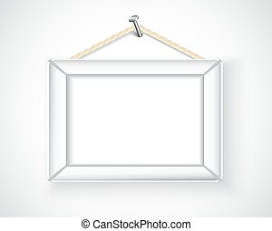 white picture frame hanging on the
