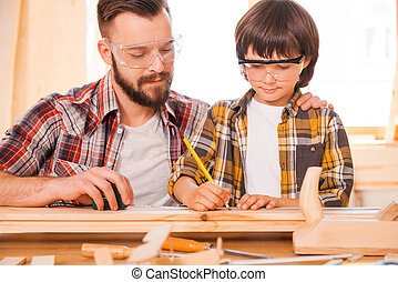 One day you will be a talented carpenter Concentrated young...