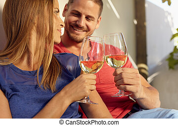 Couple in love spending time and enjoying wine
